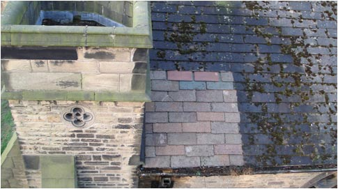 Church roof cleaning, you can clearly see the beautiful, original tiles being revealed - click to Architectural Cleaning
