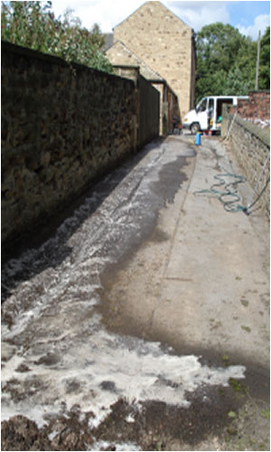 Driveway during oil spill cleaning process